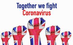 United Kingdom raised fist with Together we fight Coronavirus text