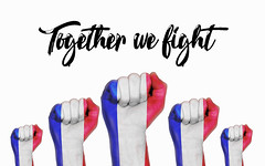 France raised fist with Together we fight text