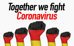 Germany raised fist with Together we fight Coronavirus text