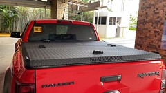 An Aluminum Truck Bed Cover On A Ford Ranger Raptor