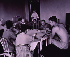 Men playing cards in quarantined area