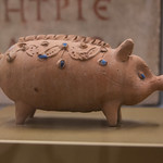 Roman ceramic piglet with blue glass-paste insets - https://www.flickr.com/people/7945858@N08/