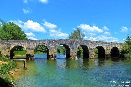 Novigrad na Dobri, Croatia - Old stone bridge over river Dobra