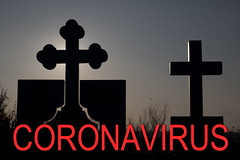 Crosses at a cemetery with Coronavirus text