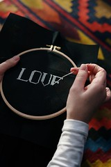 Person embroidering sewing - Credit to https://homegets.com/