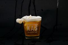 Splashing beer closeup with black background