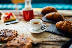 White cup of espresso coffee closeup.