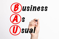 BAU - Business As Usual acronym with marker, concept background