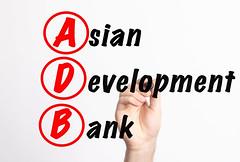ADB - Asian Development Bank acronym with marker, concept background