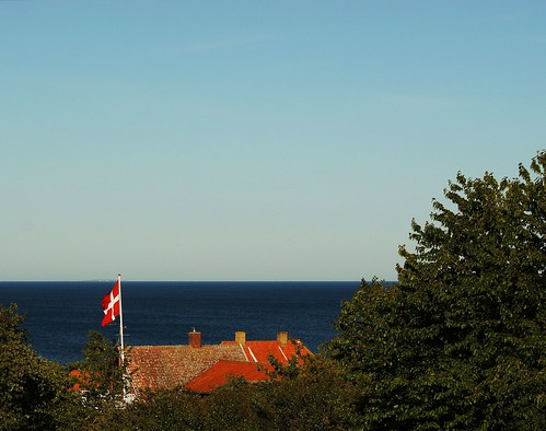 View of the Baltic Sea to the east above the Bornholm city of Allinge. Christiansø, the easternmost place in Denmark is seen on the horizon.