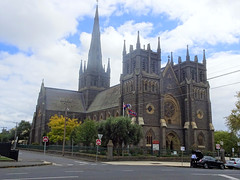 Geelong. 136 Yarra St. St Mary's Catholic Basilica built from 1854 to 1937. A grand facade with three towers spire and large rose window above the main entrance..