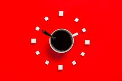 White mug on red background - Credit to https://homegets.com/