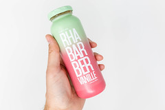 Hand holds a bottle of rhubarb-vanilla smoothie launched by true fruits as a spring 2020 special edition