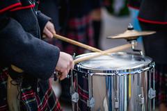 Drummer wearing a men's skirt drums