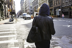 leather jacket, hoodie, and bag
