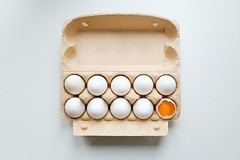 White egg on brown egg tray - Credit to https://homegets.com/