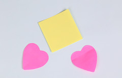 Red heart with yellow sticky note