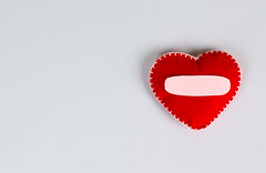 Red heart isolated on white with empty space for message