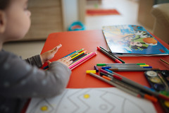 Child drawing with colorful pencils.