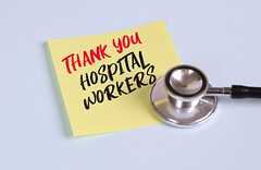 Yellow sticky note paper with stethoscope with Thank You Hospital Workers message