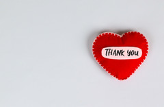 Red heart and stethoscope with Thank You message