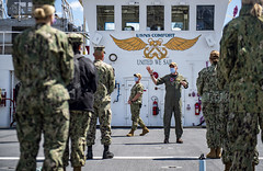 Capt. Joseph O'Brien greets more than 40 medical providers joining the Military hospital ship USNS Comfort (T-AH 20) in New York City.
