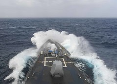 USS Normandy (CG 60) transits the Atlantic Ocean through heavy seas, April 14, 2020.