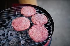 Hamburgers on a hot barbecue closeip.