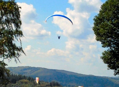 Paragliding over the horseshoe meader of the Semois at Rochehaut, Belgium