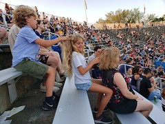 Braiding Hair At The Concert