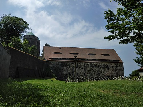 Park surrounding Stolpen castle with ancient wall and tower