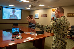 Rear Admiral congratulates newly frocked senior and master chiefs during a virtual frocking ceremony.