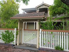 Adelaide. Toorak Gardens. Edwardian two storey home with external woodwork and decorative lychgate  at the front gate.