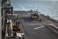An F-35B Lightning II fighter aircraft prepares to take off from the flight deck of USS America (LHA 6).
