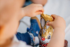 Toddler playing with a chocolate easter bunny
