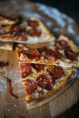 Sliced pepperoni pizza closeup.