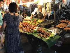 An European tourist makes a purchase in the Banzaan Night Market