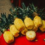 Fresh pineapple on a street food cart