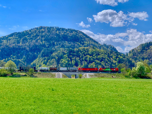 Freight train passing through the landscape near Oberaudorf, Bavaria, Germany