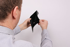 Unemployed man showing empty wallet