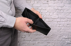 Hand opening empty wallet, office employee end of month concept