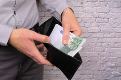 Man with Euro money in wallet, closeup