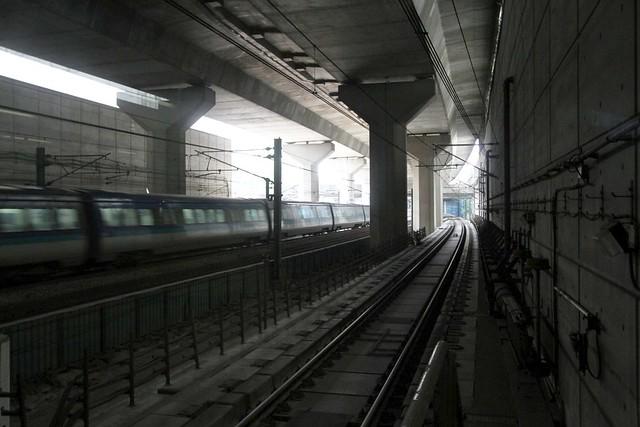 Airport bound Airport Express train runs through Nam Cheong station