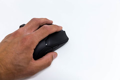 Close-up on a white background of a hand of a man using the Viper Ultimate wireless gaming mouse by Razer