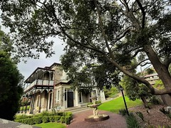 Adelaide. Torrens Park. Scotsman Alexander McGeorge built this two storey bluestone mansion in 1872. It was enlarged several times. Now has no proper street frontage so a side entrance.