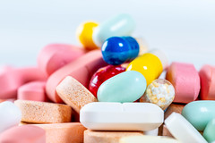 Close Up Photo of Pills in different Shapes and Colors with White Background