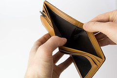 Person holding an empty Wallet with White Background