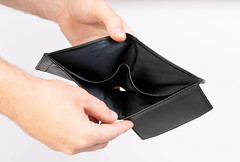 Person opening an empty black Wallet with White Background