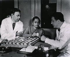 Robert Huebner and others examine eggs
