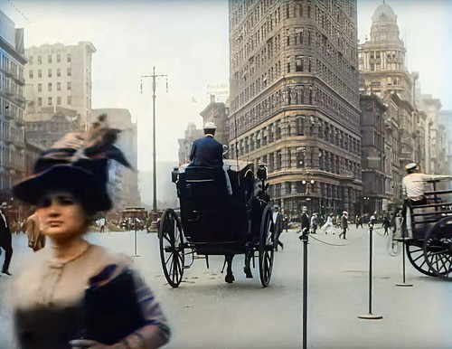 People hurry along the streets of Manhattan on their way to work at the convergence of 5th Avenue, West 23rd Street and Broadway. The Flatiron building was only nine years old when this photo was taken. New York. August 1911